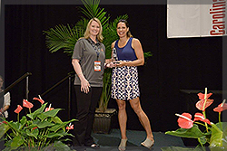 Michelle Reed accepts her Top Young Leader Award from Jessica Mendoza